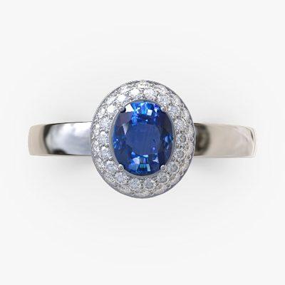 Bague saphir entourage diamants sur or blanc.